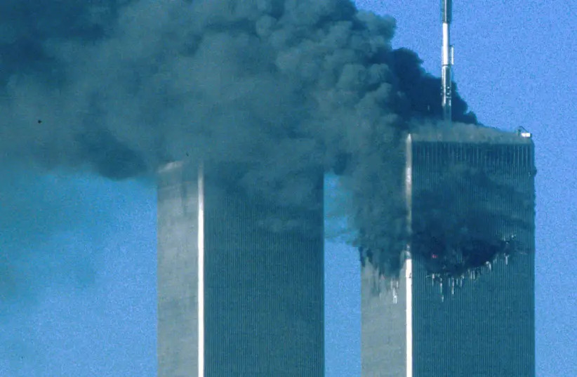 The twin towers after being hit, 9/11 (photo credit: SEAN ADAIR/ REUTERS)